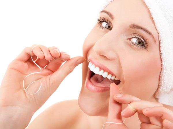 Польза и вред от зубной нити
